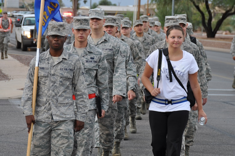 Members of the 612th Air Communications squadron embark on a Memorial March to honor 9/11 victims, Sept. 11. (U.S. Air Force photo by Master Sgt. Kelly Ogden).