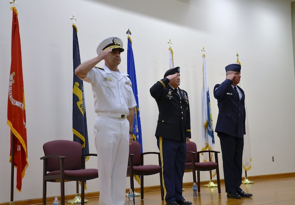 Navy Rear Adm. William M. Roberts (far left) became the second commandant of the Medical Education & Training Campus (METC) during an Assumption of Commandant ceremony September 7.  (Also pictured: Army Col. Gino Montagno, METC deputy commandant (center), and  Air Force Chief Master Sgt. Joel Berry, METC command chief (right). METC trains the world's finest medics, corpsmen, and