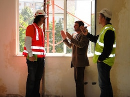 Marcelo Maier (left), a U.S. Army Corps of Engineers Europe District civil engineer for special projects conducts a site inspection of a telemedicine facility in Kukes, Albania. After one year on the job and an informal mentorship Maier is helping to build the Humanitarian Assistance program.