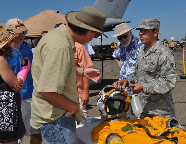 U.S. Air Force Staff Sgt. Willy Campos, 9th Physiological Support Squadron, explains the unique characteristics of the full pressure suits worn by U-2 Intelligence Reconnaissance and Surveillance aircraft pilots at the Capital City Air Show at Mather Airport, Sacramento, Calif., Sept. 8, 2012. The suits are very similar to NASA astronaut suits.  (U.S. Air Force photo by Staff Sgt. Robert M. Trujillo)