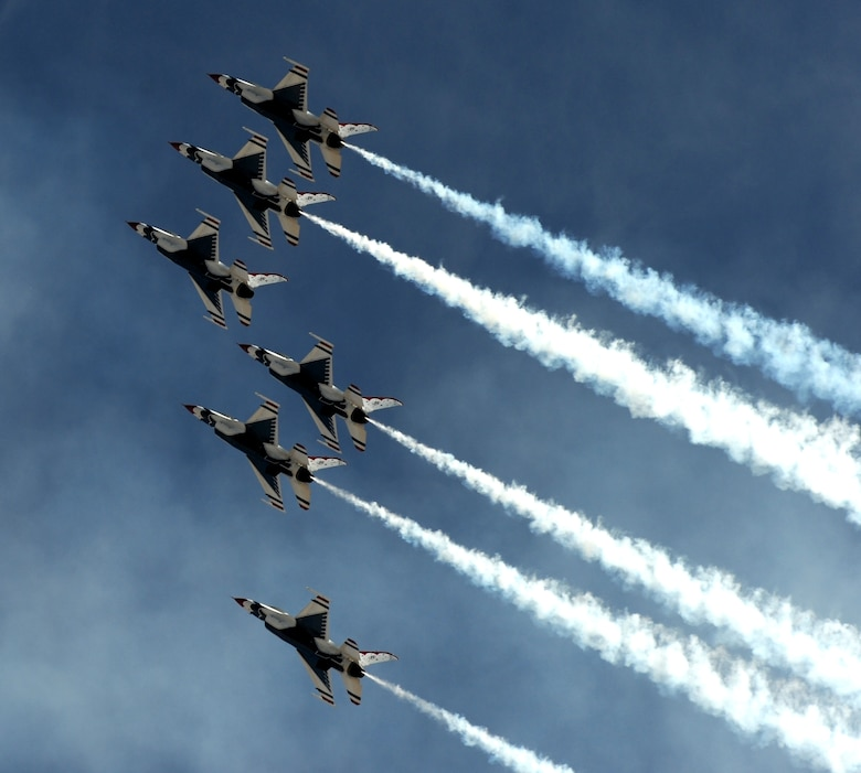 The U.S. Air Force Thunderbirds demonstration team climbs skyward during the Capital City Air Show at Mather Airport, Sacramento, Calif., Sept. 8, 2012. The Thunderbirds often fly just a few feet from wingtip to wingtip during their routines. (U.S. Air Force photo by Staff Sgt. Robert M. Trujillo)