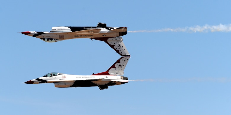 The U.S. Air Force Thunderbirds demonstration team performs an inverted maneuver during the Capital City Air Show at Mather Airport, Sacramento, Calif., Sept. 8, 2012. More than 100,000 people attend this annual event. (U.S. Air Force photo by Staff Sgt. Robert M. Trujillo)