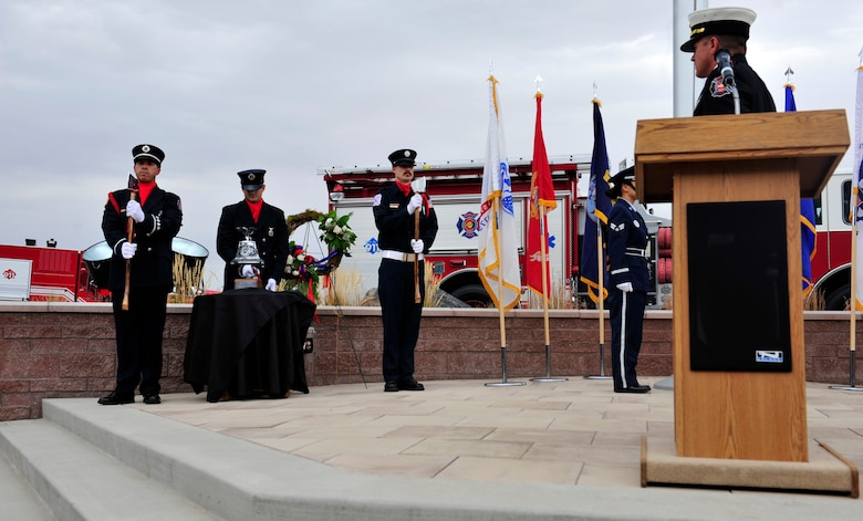 BUCKLEY AIR FORCE BASE, Colo. – An Aurora Fire Department Honor Guardsman rings a ceremonial bell in observance of Patriot Day at the 460th Space Wing headquarters building Sept. 11, 2012. The ringing of the bell memorialized the firefighters who died responding to the 9/11 terrorist attacks in New York City. (U.S. Air Force photo by Airman 1st Class Darryl Bolden Jr.)