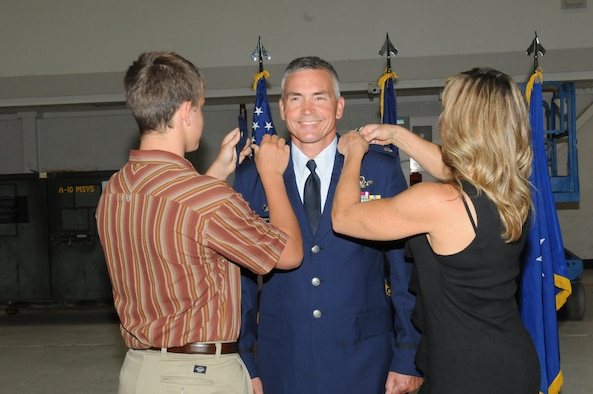 Newly promoted Maintenance Group Commander Col. David Trimble with son Dylan and wife Julie at Gowen Field, Boise, Sept. 7.