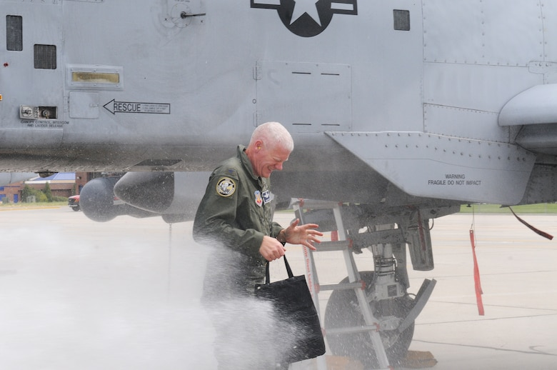 Before accepting his new position as commander of the 124th Mission Support Group at Gowen Field, Col. Alan Clarke celebrates his Finis Flight at Boise, Idaho, Sept. 6.