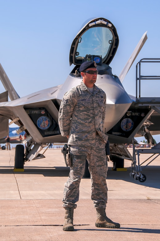 BROOMFIELD, Colo. – Staff Sgt. Trevor Simms, 460th Security Forces Squadron, provides security for an F-22 Raptor from Holloman Air Force Base, N.M., during the Rocky Mountain Airshow at the Rocky Mountain Metropolitan Airport. Eight Airmen provided 24-hour security for the F-22 aircraft, which were a highlight of the airshow held the last weekend in August. (Photo by Scott E. Wolff)