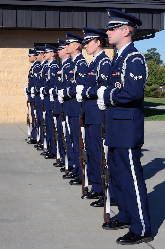 Members of the 4th Fighter Wing Honor Guard stand at parade rest awaiting the order to begin a 21-gun salute during the 9/11 Remembrance Ceremony on Seymour Johnson Air Force Base, N.C., Sept. 11, 2012. Airmen began the ceremony with a 24 hour memorial run carrying a 9/11 Remembrance Flag to pay tribute to those who lost their lives. (U.S. Air Force photo/Airman 1st Class John Nieves Camacho/Released)