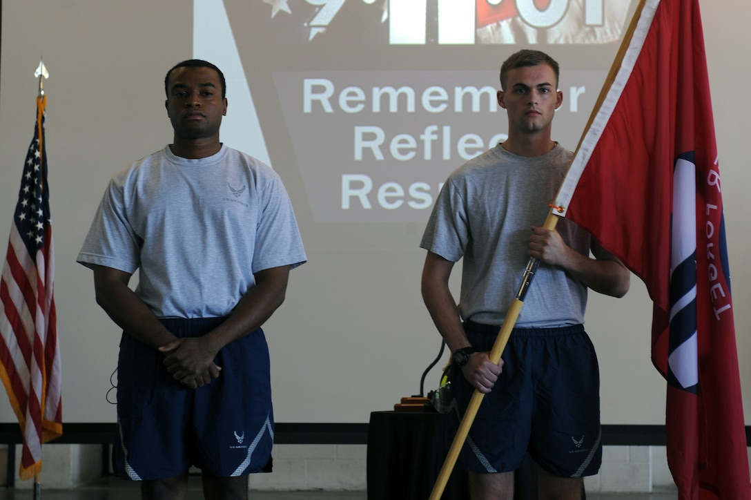 U.S. Air Force Staff Sgt. Decota Thomas (left), 4th Security Forces Squadron fitness monitor, and Airman 1st Class Benton Vandergrift, 4th Civil Engineer Squadron firefighter, await the signal to begin a 24-hour run on Seymour Johnson Air Force Base, N.C., Sept. 11, 2012. Seymour Johnson personnel are conducted a 24-hour run in honor of those killed in the 9/11 attacks. (U.S. Air Force photo/Airman 1st Class John Nieves Camacho/Released)