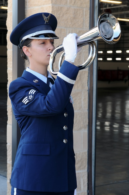 U.S. Air Force Senior Airman Melissa Wallace sounds TAPS during the 9/11 Remembrance Ceremony on Seymour Johnson Air Force Base, N.C., Sept. 11, 2012. The hour-long ceremony included a color guard consisting of firemen and defenders, a slide show documenting the terrorist attacks, four guest speakers and a 21-gun salute by 4th Fighter Wing Base Honor Guard Airmen. (U.S. Air Force photo/Airman 1st Class John Nieves Camacho/Released)