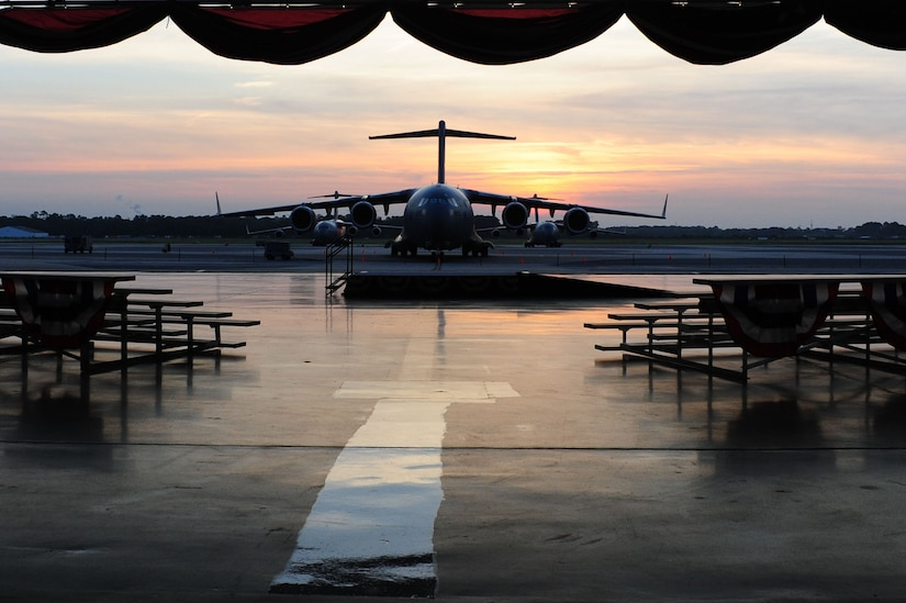 """The sun rises over at C-17 during the filming of the Lifetime drama series Army Wives, at Nose Dock 1, June 20, 2012, at Joint Base Charleston - Air Base, S.C. Army Wives tells the story of four women and one man who are brought together by their common bond – they all have military spouses. The series is based on the book """"Under the Sabers: The Unwritten Code of Army Wives"""" by Tanya Biank. Army Wives is produced by ABC Television Studio and The Mark Gordon Company.  (U.S. Air Force photo/ Airman 1st Class Chacarra Walker)"""