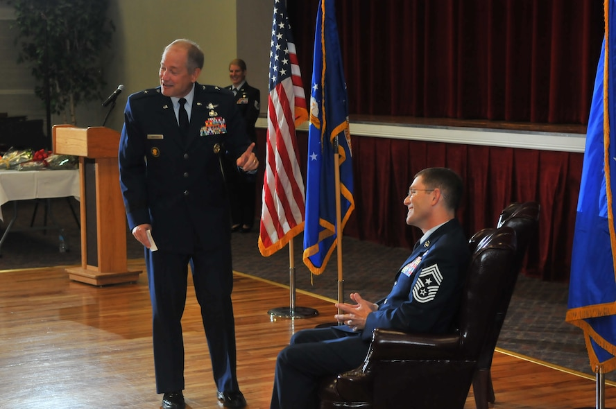 "JOINT BASE SAN ANTONIO–LACKLAND, Texas -- Brig. Gen. Kevin Wooton, Air Force Space Command Communications and Information director, shares a moment of reflection with Chief Master Sgt. Mark Renninger, the former 67th Network Warfare Wing command chief master sergeant, during the chief's retirement ceremony at Arnold Hall here, Sept. 5. Wooton hired Renninger on as his command chief when he was in command of the 67th NWW and refers to him as ""The Quiet Professional."" (U.S. Air Force photo by William Belcher)"