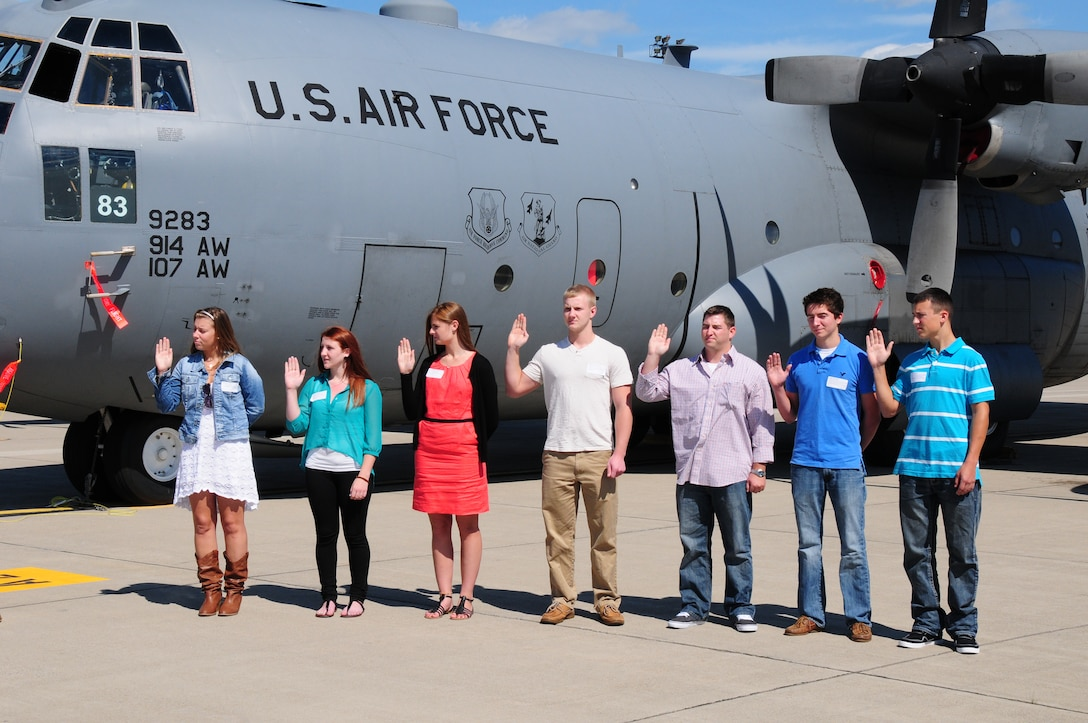 The 107th Airlift Wing remembers 9/11 by enlisting new airmen into the unit. Seven new members join the Air National Guard on Sept. 11, 2012. From left to right are Airman 1st Class Kirsten Peyton, Airman Lauren Libassi, Airman 1st Class Catherine Stoddard, Airman 1st Class Thomas Leaming, Senior Airman Shannon Carr, Airman Kyle Druzbik, and Airman John Danvir.  (U. S. Air Force Photo/Senior Master Sgt. Ray Lloyd)