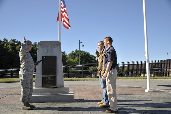 Taylor Gosse (right) and Andrew Jenkerson enlisted into the N.H. Air National Guard by Col. Peter Sullivan outside the 157th Air Refueling Wing headquarters, Pease Air National Guard Base, N.H., September 11, 2012.