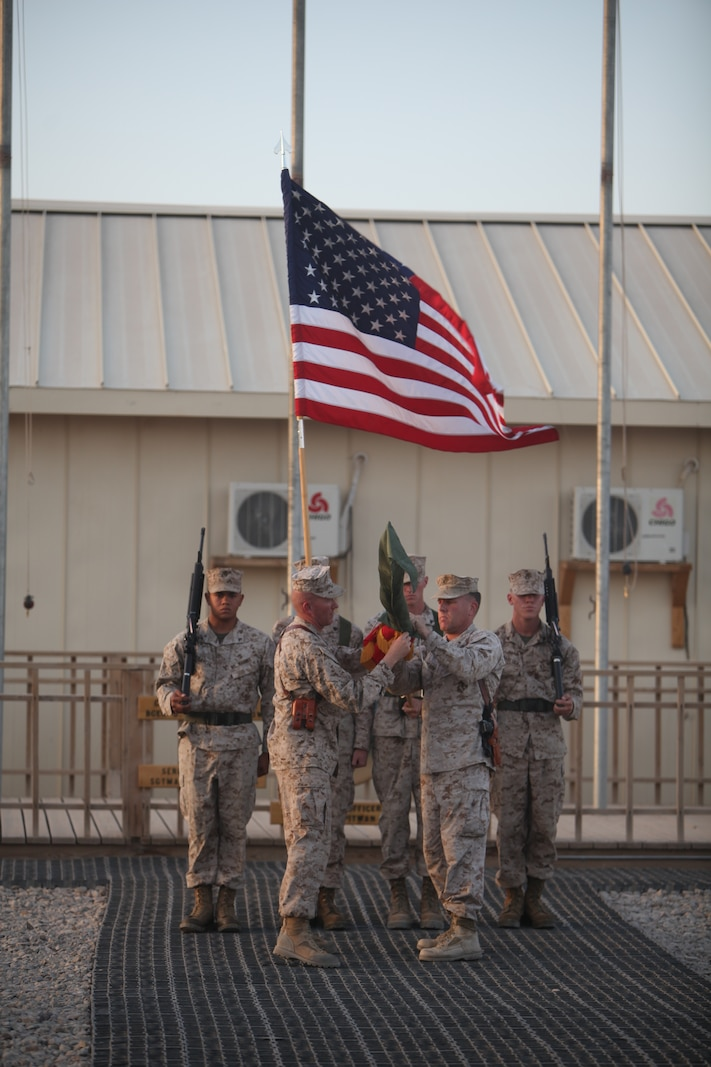 Brig. Gen. John J. Broadmeadow (right), commanding general of 1st Marine Logistics Group (Forward) and Sgt. Maj. William T. Sowers, Combat Logistics Regiment-15 sergeant major, case the 1st MLG (Fwd) unit colors during a transfer of authority ceremony, Sept. 10. During their approximate seven month deployment, members of 1st MLG (Fwd) provided exceptional tactical logistics support to the International Security Assistance Force Marine Air-Ground Task Force.