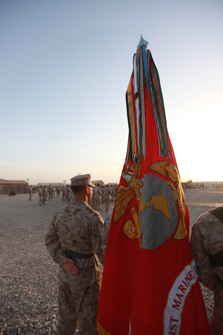 Cpl. Justin Barlock, a member of the Combat Logistics Regiment-15 color guard, stands at parade rest before the start of a transfer of authority ceremony from 1st Marine Logistics Group (Forward) to CLR-15, Sept. 10. The ceremony represented a change in leadership. More importantly though, it symbolized continuity in the steadfast support provided by the Marines and sailors of the logistics combat element.