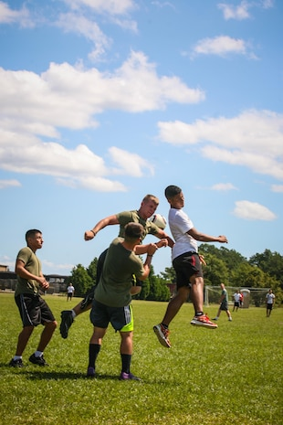 Marines and sailors with 2nd Battalion, 8th Marine Regiment, compete in a soccer game as part of the 2/8 Olympics. The unit gave their weathered camouflage utilities a week-long break to carry out a battalion size Olympics promoting unit cohesion and competitive spirits.