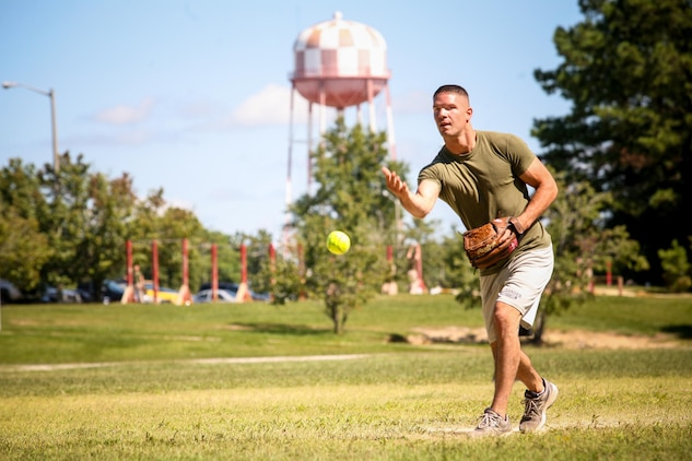 Lance Cpl. Jacob Fransisco of Taylorsville, N.C., and a team leader with 2nd Battalion, 8th Marine Regiment, pitches a softball during a 2/8 Olympics softball game. The battalion gave their weathered camouflage utilities a week-long break to carry out a battalion size Olympics promoting unit cohesion and competitive spirits.