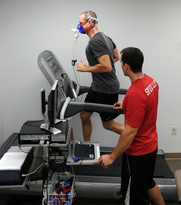 U.S. Air Force Lt. Col John McArthur, 355th Medical Support Squadron Radiology Flight chief, tests out the metabolic cart while David Friederich, Health and Wellness Center health and fitness specialist, monitors his activity at the HAWC on Davis-Monthan Air Force Base, Ariz., Sept. 11, 2012. The test takes approximately 8-12 minutes to complete. (U.S. Air Force photo by Airman 1st Class Christine Griffiths/Released)