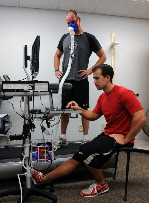 U.S. Air Force Lt. Col. John McArthur, 355th Medical Support Squadrons Radiology Flight chief, and David Friederich, Health and Wellness Center health and fitness specialist set up the metabolic cart prior to using the device at the HAWC on Davis-Monthan Air Force Base, Ariz., Sept. 11, 2012. The Metabolic cart measures your aerobic fitness. (U.S. Air Force photo by Airman 1st Class Christine Griffiths/Released)