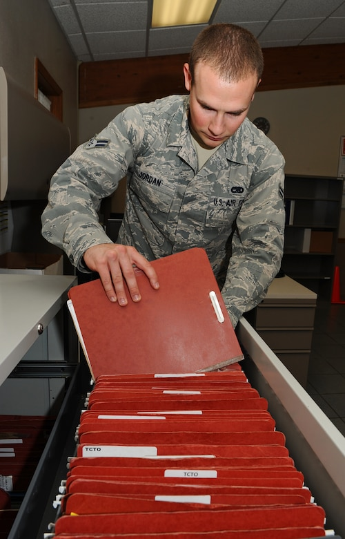 Airman 1st Class Ben Jordan, 2nd Maintenance Operations Squadron assistant time compliance technical order monitor, files a TCTO on Barksdale Air Force Base, La., Sept. 6. When there is a time-sensitive need to upgrade a part of an aircraft or piece of equipment, a TCTO is submitted. (U.S. Air Force photo/Airman 1st Class Benjamin Gonsier)(RELEASED)