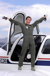 Cadet 1st Class Staci Rouse emerges enthusiastically from a T-53A trainer that she flew solo, marking a historic first for the Air Force Academy's powered flight program. Rouse, a native of Woodridge, N.J., is assigned to Cadet Squadron 40. (U.S. Air Force photo/Mike Kaplan)
