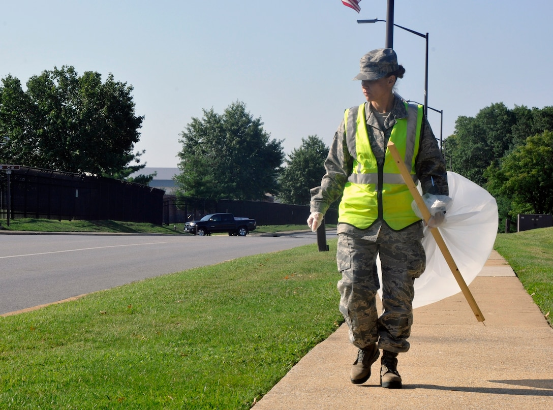 Senior Airman Tammy Workman, 744th Communications Group base records assistant, monitors Arkansas Ave. Aug. 16, 2012, for scattered litter. As a part of Andrews' Base Pride detail, Workman works the week-long detail with approximately 5 other Airmen maintaining installation cleanliness and upholding Andrews' sanitation standards. (U.S. Air Force photo/Senior Airman Lindsey A. Porter)