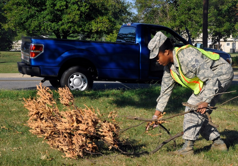 Senior Airman Cornelie Hall, 779th Medical Support Squadron command support staff and Base Pride detail Airman, collects tree debris Aug. 16, 2012. Base Pride is a week-long detail that works to maintain installation cleanliness and uphold Andrews' sanitation standards. (U.S. Air Force photo/Senior Airman Lindsey A. Porter)
