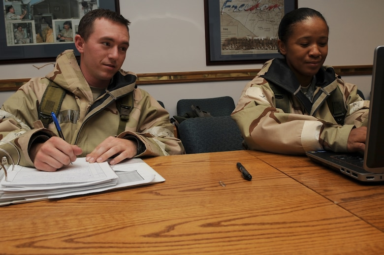U.S. Air Force Senior Airman Ryan Willis and Staff Sgt. Carla Owens, 366th Fighter Wing knowledge operations managers, man the Unit Control Center during an Operational Readiness Exercise Sep.13, 2012 at Mountain Home Air Force Base, Idaho. In order to make well-informed decisions, commanders in the exercise rely on timely and accurate information from the UCC.