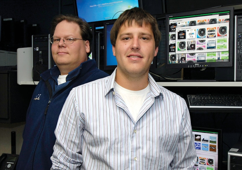 Blake Davis, front, and Jeff Foltz made the ease of getting technical orders on line even easier when they created a new application for mechanics. The 72nd Communications Directorate developers made an easy-to-navigate site where finding a specific engine or aircraft technical order is a click away. (Air Force photo by Margo Wright)
