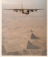 A C-130 of the 130th Tactical Airlift Group, West Virginia Air National Guard, flies over the Pyramids of Giza, Egypt, 1981.