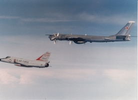 "An F-106A Delta Dart of the 177th Fighter Interceptor Group, New Jersey Air National Guard, escorts a Soviet Tu-95RT (""Bear"") maritime surveillance aircraft off the U.S. East Coast, around 1980."