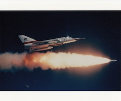 An F-106 Delta Dart of the 144th Fighter Interceptor Wing fires a Genie air-to-air missile at the William Tell aerial gunnery competition at Tyndall AFB, Florida, 1980.