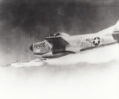 """An Air National Guard F-86D/L interceptor fires its 2.75-inch """"Mighty Mouse"""" rockets. Jet fighters closing with jet bombers at over 1,000 miles per hour at night or in bad weather could not count on hitting their target with machine guns, even with the aid of radar and early computers. Before the advent of guided air-to-air missiles, many U.S. interceptor types were armed with unguided rockets fired in large salvos in an effort to increase the probability of a hit."""