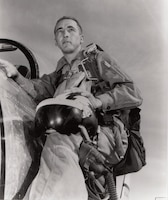 "Major James Robinson (""Robbie"") Risner posed with F-86, probably Kimpo, Korea, ca. 1952. After serving as a fighter pilot in World War II, Robbie Risner joined the Oklahoma Air National Guard and was recalled to active duty in February 1951. Serving with the 336th Fighter-Interceptor Squadron, Risner shot down eight MiG-15 fighters."
