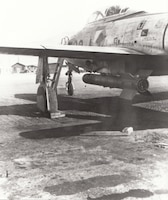 An F-84 of the 154th Fighter-Bomber Squadron, Arkansas Air National Guard, loaded with 11.75-inch Tiny Tim rockets, Taegu, Korea, February 1952. Developed late in World War II for use against shipping and fortified targets, the Tiny Tim mated a 500-pound semi-armor-piercing bomb with a rocket motor built into a length of oil well tubing. Photo by C.W. Ellis, courtesy of Warren Thompson.