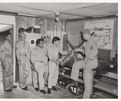 Armament specialists of the Hawaii Air National Guard train to load the .50-caliber machine guns used in the F-47 Thunderbolts that made up the bulk of the early ANG aircraft inventory.