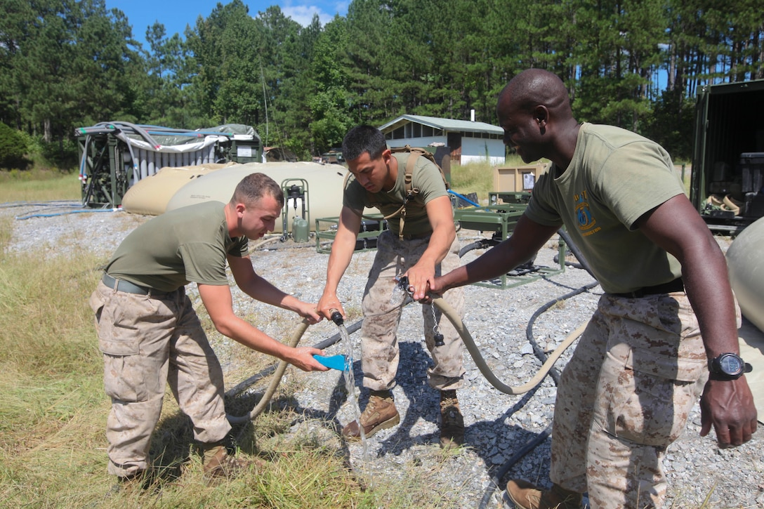 Water purification specialists with Combat Logistics Battalion (CLB) 26, 26th Marine Expeditionary Unit (MEU), test their filtered water's purity at Fort Pickett, Va., Sept. 10, 2012. The Marines are testing the battalions new lightweight water purification system capable of producing up to 450 gallons of clean water per hour from any available water source. This field testing is part of the 26th MEU's pre-deployment training program. CLB-26 is one of the three reinforcements of 26th MEU, which is slated to deploy in 2013.