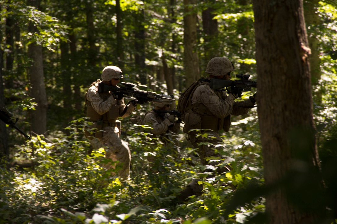 Marines with 2nd Squad, 2nd Platoon, Company K, Battalion Landing Team (BLT) 3/2, 26th Marine Expeditionary Unit (MEU), run a squad assault course at Fort Pickett, Va., Sept. 11, 2012. This training is part of the 26th MEU's pre-deployment training program. BLT 3/2 is one of the three reinforcements of 26th MEU, which is slated to deploy in 2013.