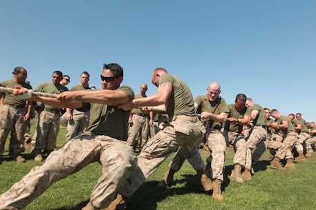 First Lt. MarkAnthony Villanueva, platoon commander, 1st Tank Battalion, takes the center position in the tug of war during the 1st Tanks' field meet at Del Valle Field Aug. 31, 2012.