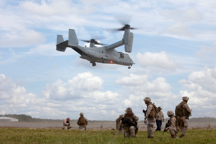 Marines with Combat Logistics Battalion (CLB) 26, 26th Marine Expeditionary Unit (MEU), assess a mass casualty, during a simulation, while awaiting an MV-22B to drop off more Marines at Fort Pickett, Va., Sept. 14, 2012. A mass casualty is defined as any number of casualties produced in a relatively short period of time that overwhelms the emergency medical services and logistical support. This training is part of the 26th MEU?s pre-deployment training program. CLB-26 is one of the three reinforcements of 26th MEU, which is slated to deploy in 2013.