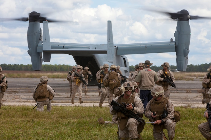 Marines with Combat Logistics Battalion (CLB) 26, 26th Marine Expeditionary Unit (MEU), land in an MV-22B Osprey and set up a perimter during a mass casualty exercise at Fort Pickett, Va., Sept. 14, 2012. A mass casualty is defined as any number of casualties produced in a relatively short period of time that overwhelms the emergency medical services and logistical support. This training is part of the 26th MEU?s pre-deployment training program. CLB-26 is one of the three reinforcements of 26th MEU, which is slated to deploy in 2013.