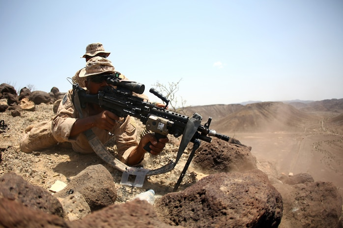 Lance Cpl. Martin Williams, an automatic rifleman with 1st Platoon, Bravo Company, Battalion Landing Team 1st Battalion, 2nd Marine Regiment, 24th Marine Expeditionary Unit, fires an M-249 Squad Automatic Weapon during high-angle marksmanship training as part of a three-week training package in Djibouti, Sep. 15, 2012. The training was focused on the application of infantry skills in rugged mountain terrain. The 24th MEU is deployed with the Iwo Jima Amphibious Ready Group as a theater reserve and crisis response force throughout U.S. Central Command and the Navy's 5th Fleet area of responsibility.