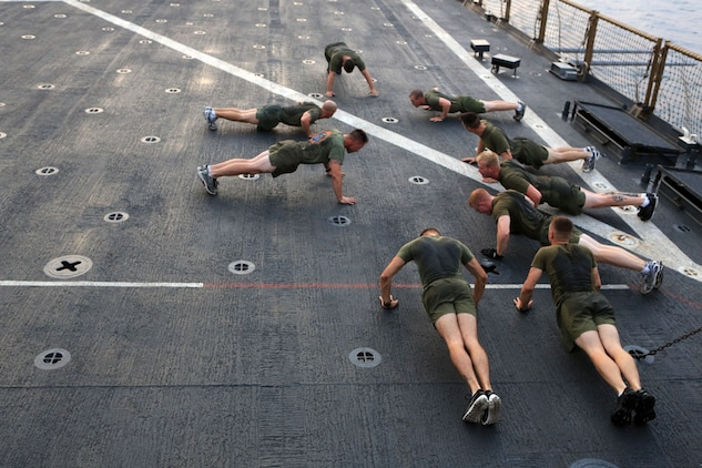Corporals with the 24th Marine Expeditionary Unit conduct morning physical training on the flight deck of the USS Gunston Hall in the Gulf of Aden, Sept. 15. The PT was part of a command-sponsored Corporal's Course that took place both ashore in Kuwait and aboard the ship. The 24th MEU is deployed with the Iwo Jima Amphibious Ready Group as a theater reserve force for U.S. Central Command and is providing support for maritime security operations and theater security cooperation efforts in the U.S. Navy's 5th Fleet area of responsibility.