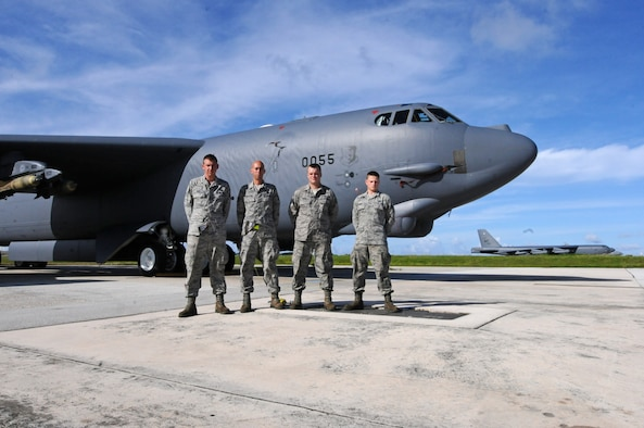 "ANDERSEN AIR FORCE BASE, Guam  -- ""Nine-O-Nine"" award winners Airman 1st Class Daniel Greig, Staff Sgt. Timothy Knighting, Staff Sgt. Jason Hanna, Senior Airman Mathew Phinney, 36th Expeditionary Aircraft Maintenance Squadron crew chiefs, stand in front of B-52 Stratofortress A0055 on the flightline here, July 24. Under the aircrew's care, B-52 A1040 accomplished 20 consecutive sorties without a maintenance abort. (U.S. Air Force photo by Senior Airman Carlin Leslie/Released)"
