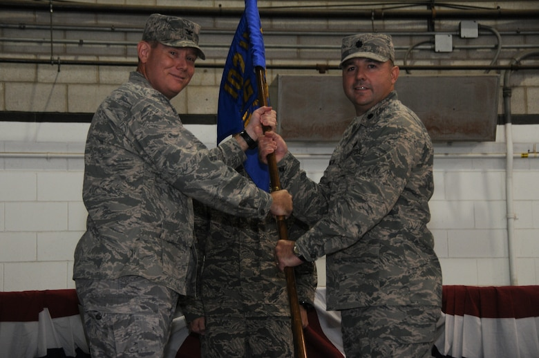 Col. Patrick J. Cobb, 102nd Intelligence Wing commander, passes the 102nd Mission Support Group flag to Lt. Col. Christopher Hamilton during a change of command ceremony at Otis Air National Guard Base, Mass., Sept. 15, 2012. Hamilton's previous assignment was 102nd Security Forces Squadron commander. (Air National Guard photo by Senior Airman Patrick McKenna/Released)