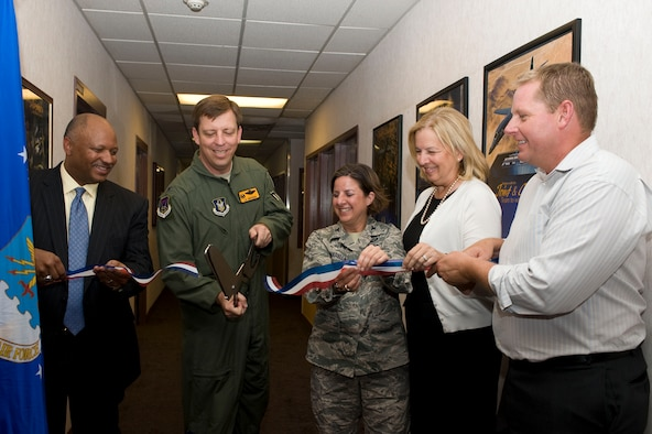 (Left to Right) Mr. Dwight Jones, Clark County School District superintendent, Col. John Breeden, 926th Group commander, Col. Carol Yannarella, 99th Air Base Wing vice commander, Ms. Barbara Koscak, STARBASE founder, and Mr. Myles Judd, STARBASE NELLIS director, cut the ribbon signifying the official opening of the STARBASE NELLIS academy during a ceremony here Sept. 12. (U.S. Air Force photo/Airman First Class Christopher Tam)