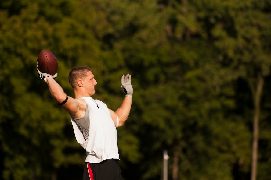 Airman 1st Class Danny Bise throws a football during practice August 23, 2012, at Burns Park in Little Rock, Ark. Bise plays wide receiver for the Arkansas Sabers, a semi-pro football team that plays in the Alliance Football League. (U.S. Air Force photo by Staff Sgt. Russ Scalf)