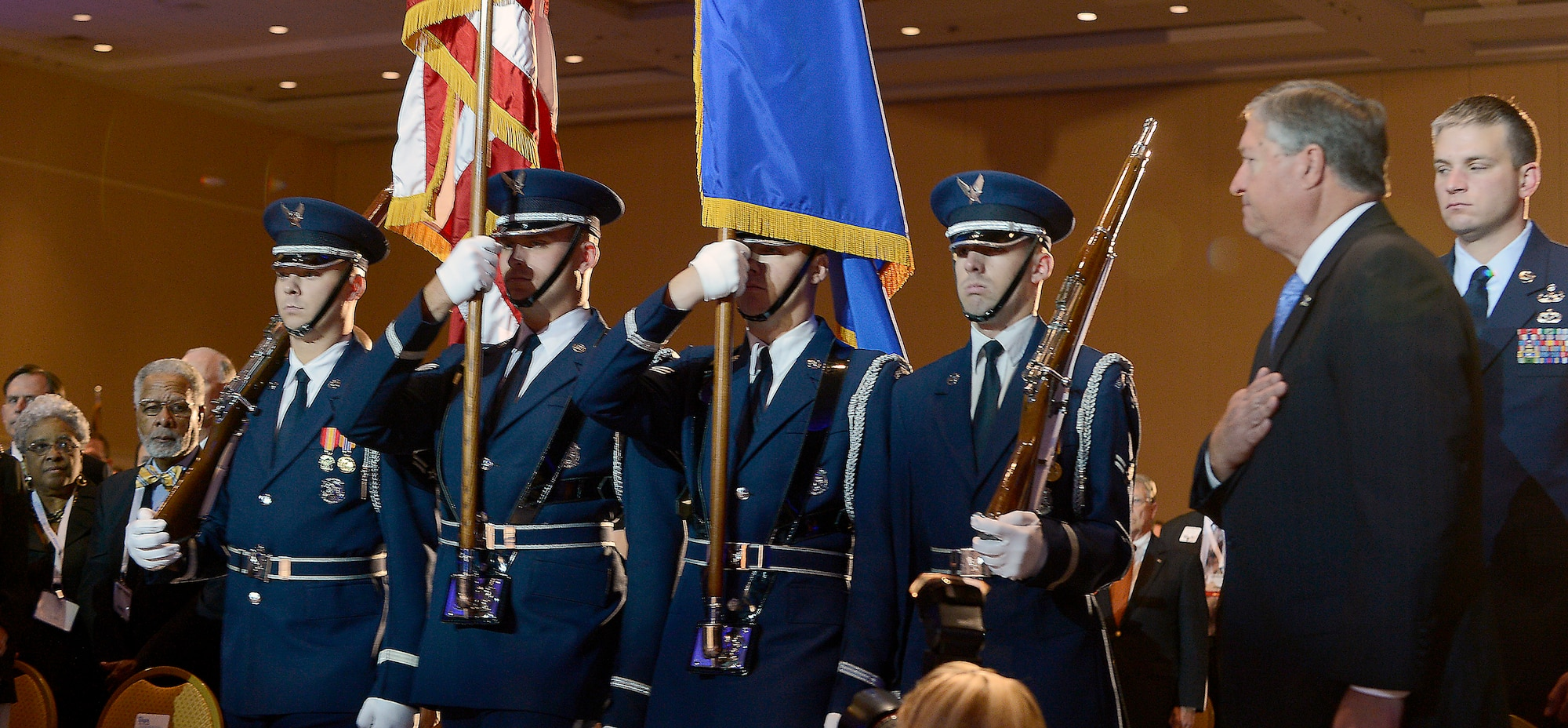 Honor guard members prepare to post the colors as Secretary of the Air Force Michael Donley looks on during the opening ceremony of the Air Force Association's Air and Space Conference and Technology Exposition in Washington, D.C., Sept. 17, 2012. (U.S. Air Force photo/Scott M. Ash)