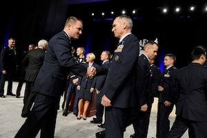 Gen. Michael Hostage congratulates an award recipient during the opening ceremonies of the Air Force Association's Air and Space Conference and Technology Exposition in Washington, D.C., Sept. 17, 2012. Hostage is commander of Air Combat Command. (U.S. Air Force photo/Scott M. Ash)