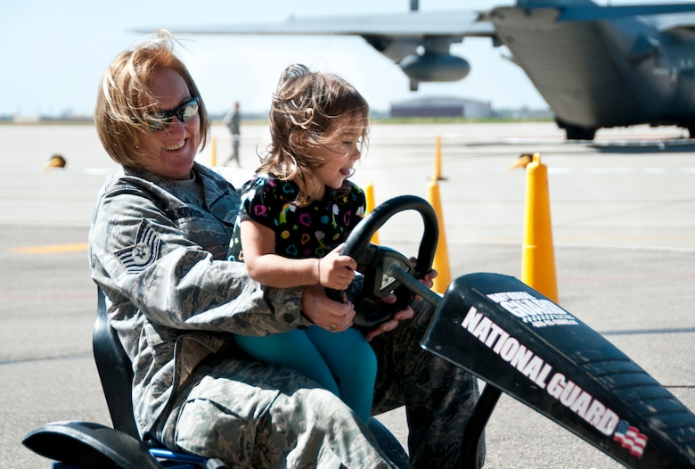 "The 133rd Airlift Wing held its annual family day Sept. 15, 2012 St. Paul, Minnesota the event was officially kicked off in the Wing's north hanger by Wing Commander Colonel Greg A. Haase, as he shared some details about the past year of the Wing and its future. Events for children and family members included a fish pond, archery, climbing wall, hay ride, bean bag toss, hammer bell, bouncing room, hay rides, and a home run derby. The static display of one of the Wing's C-130 ""Hercules"" cargo aircraft on the flightline always one of the most popular attractions for families to explore. Food was provided free of charge and served by Fat Lorenzo's of Minneapolis to the Airmen and their families. Air Force by Staff Sgt. Austen Adriaens/released"